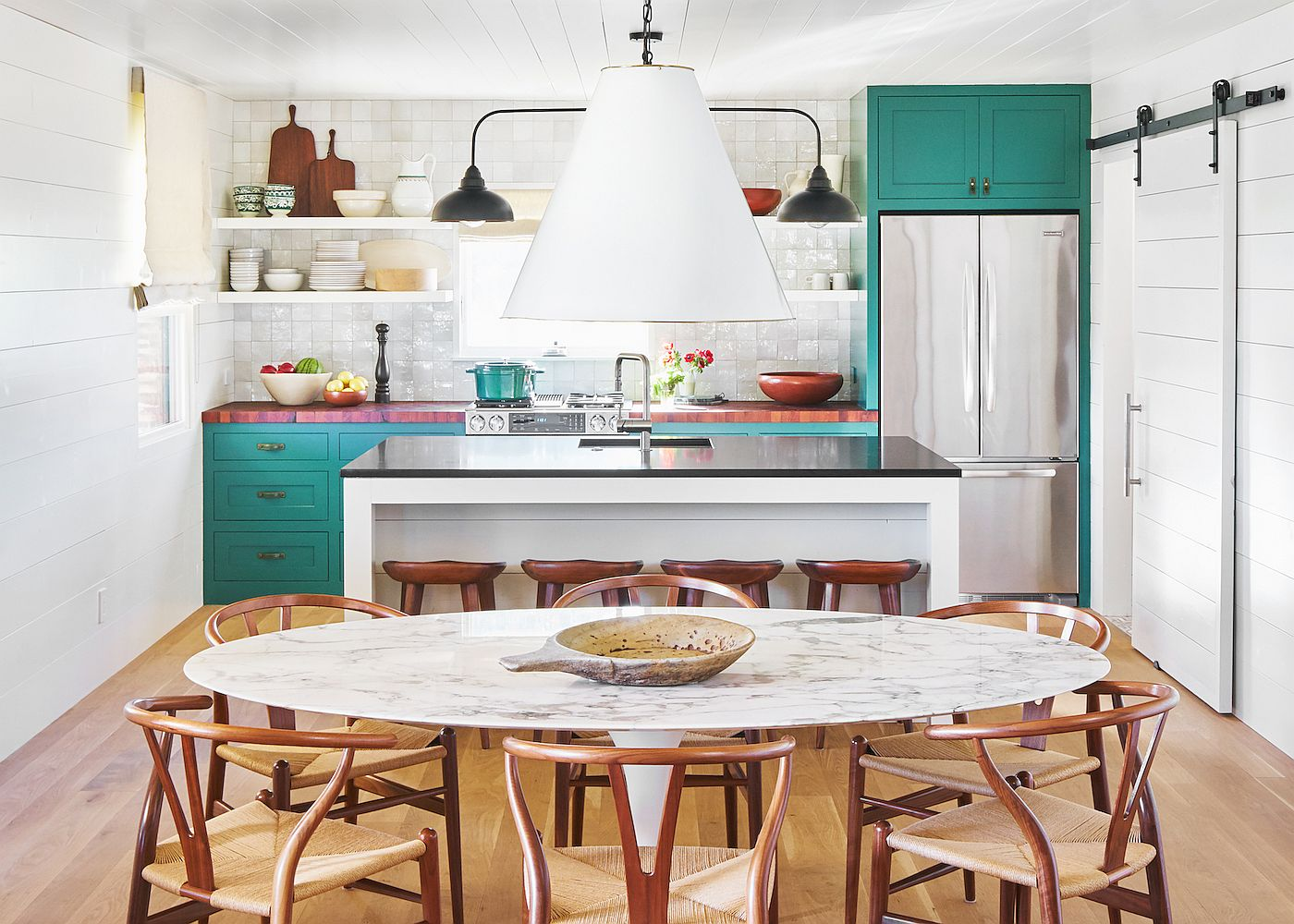 Small-and-elegant-ranch-style-kitchen-in-Texas-home-with-tiled-backsplash-and-teal-cabinets-47382