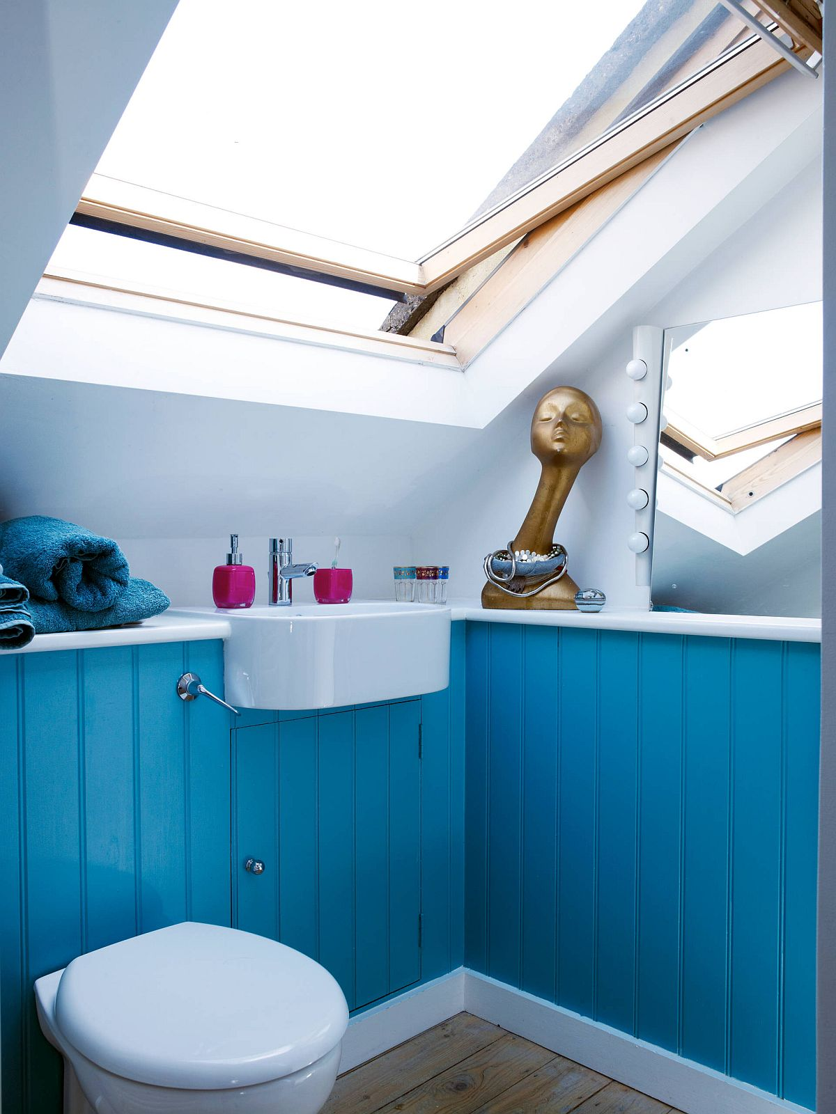Small attic bathroom in lovely blue and white with plenty of natural light