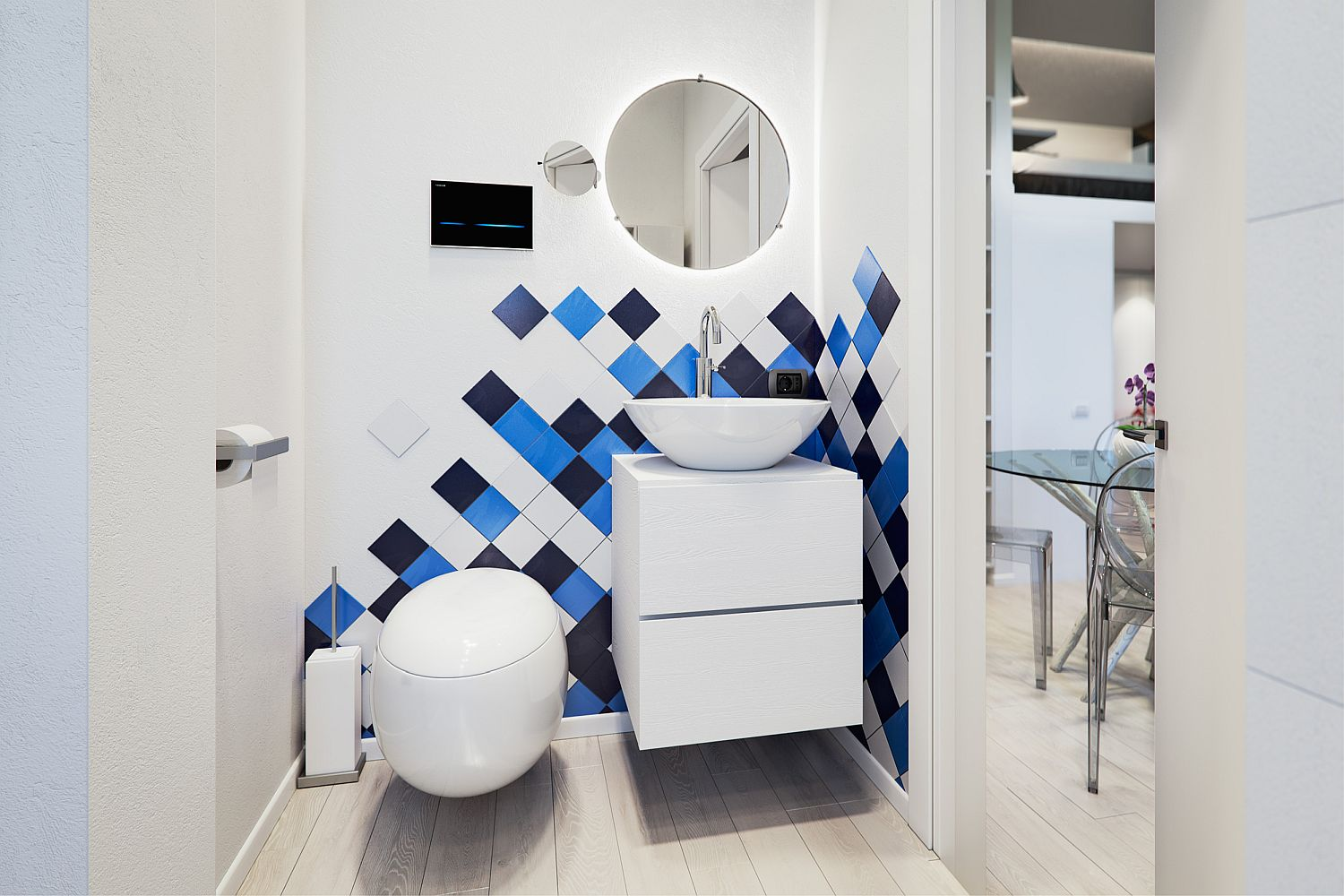 Small bathroom in white with pops of blue and dark gray