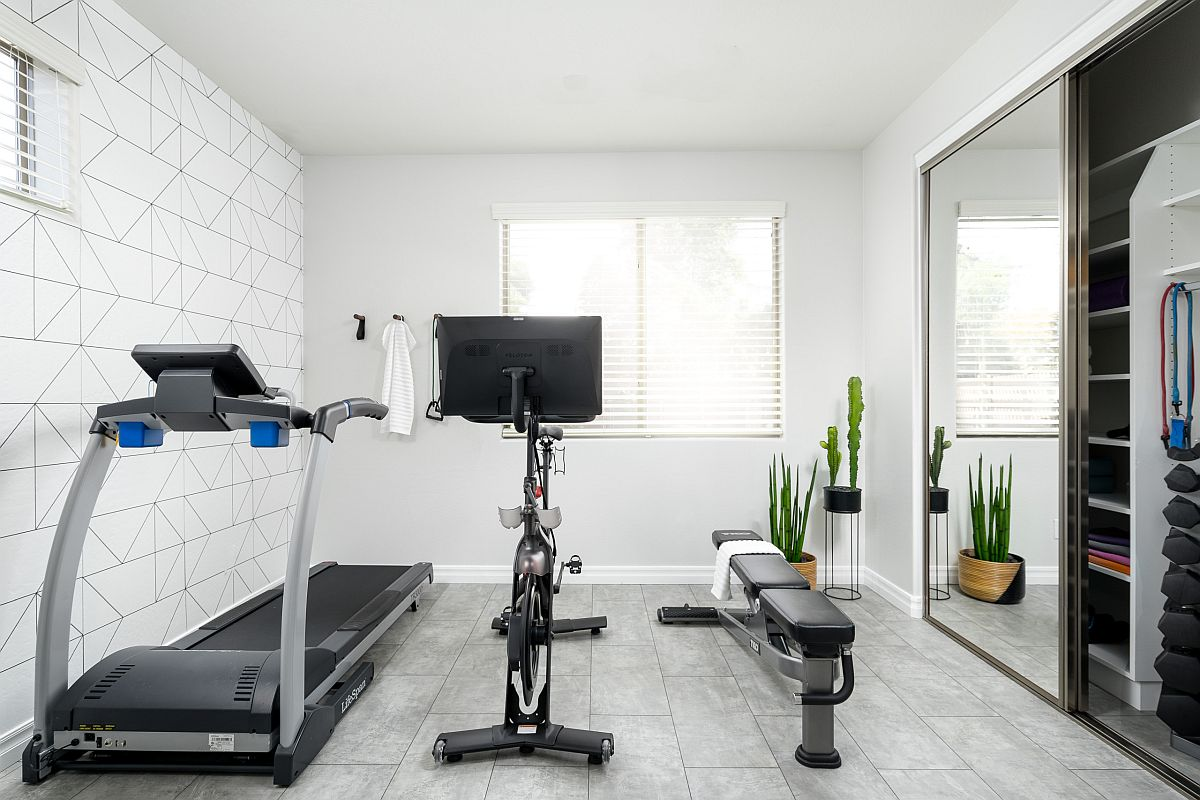 Small-home-gym-in-white-with-sliding-glass-door-cabinet-to-tuck-away-all-your-workout-equipment-37175