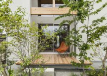 Small-wooden-deck-of-the-house-surrounded-by-greenery-provides-a-relaxing-refuge-10337-217x155