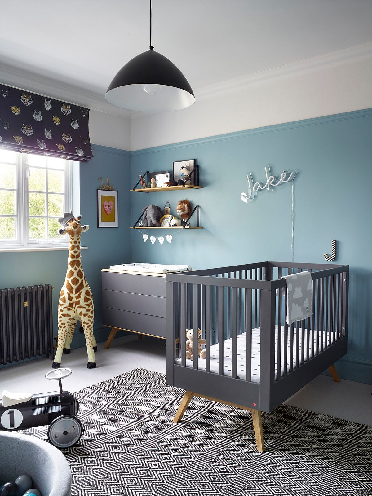 Smart contemporary nursery in white and light blue with gray crib