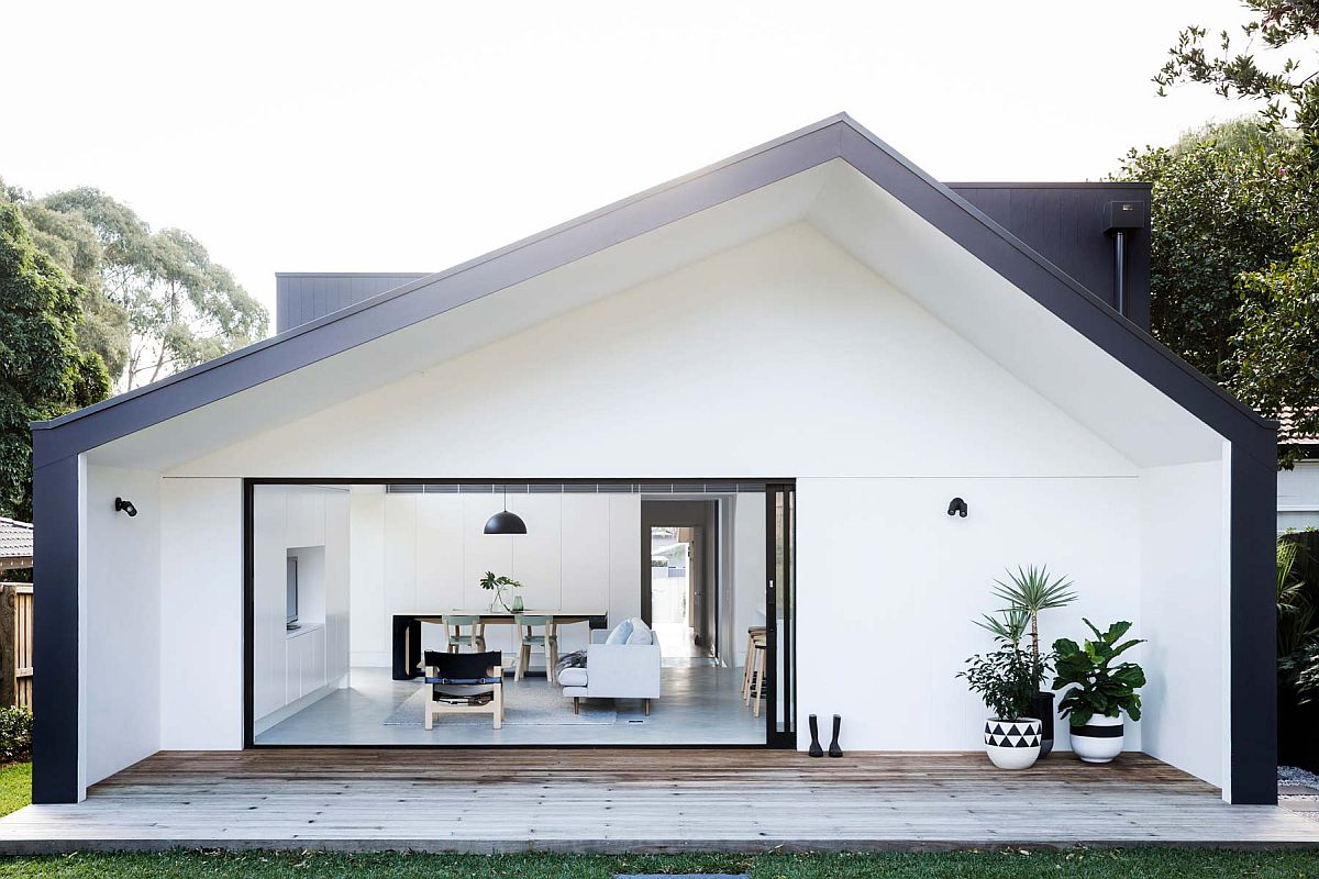Smart shed-style design of the home in white with dark trims revamps the appeal of the Californian bungalow