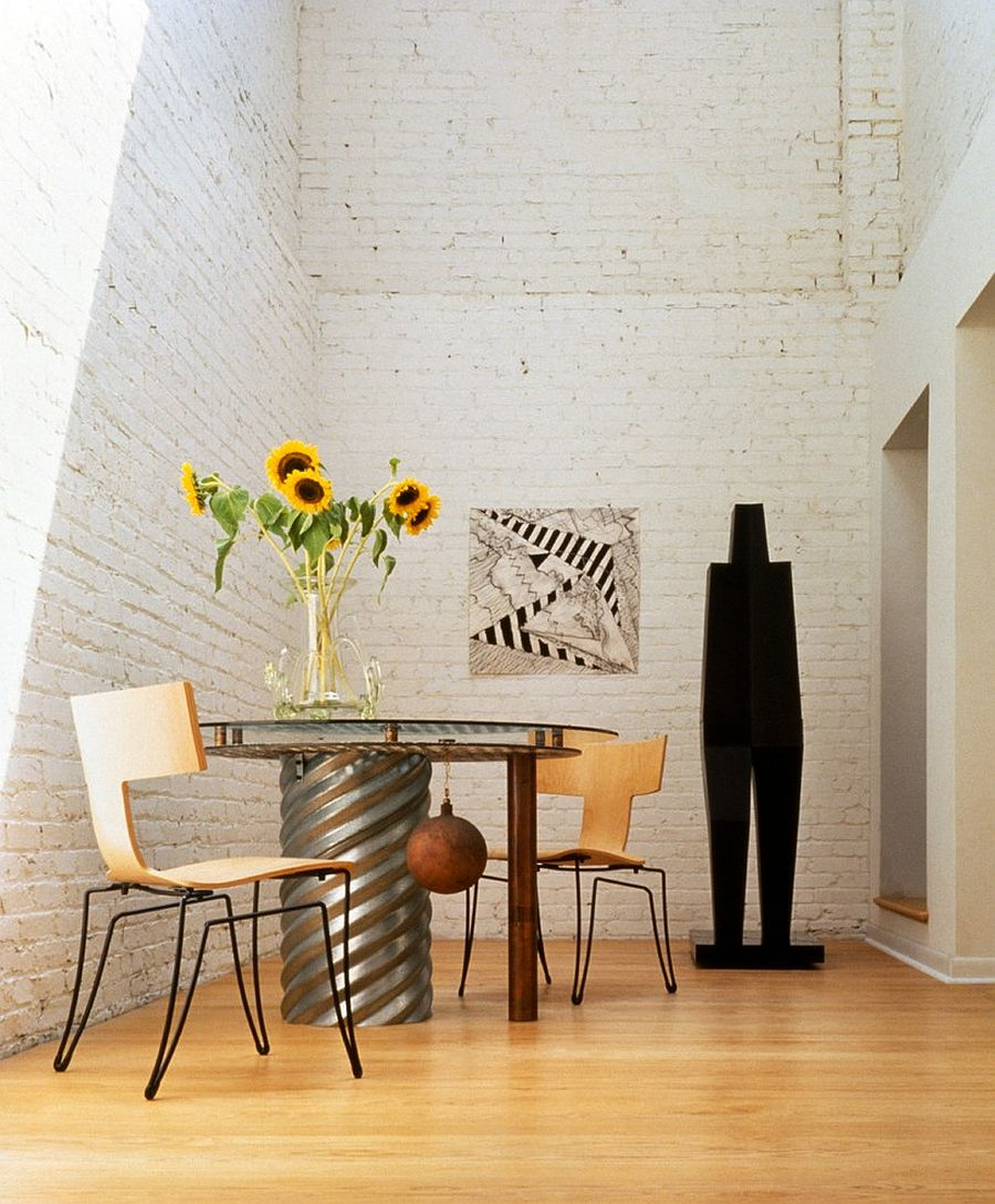 Spacious-dining-area-in-revamped-home-with-white-brick-walls-and-plenty-of-natural-light-37245