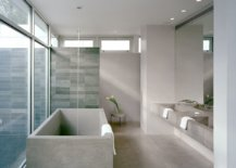 Spacious-modern-bathrom-of-New-York-home-in-gray-with-blu-tiled-shower-area-75924-217x155