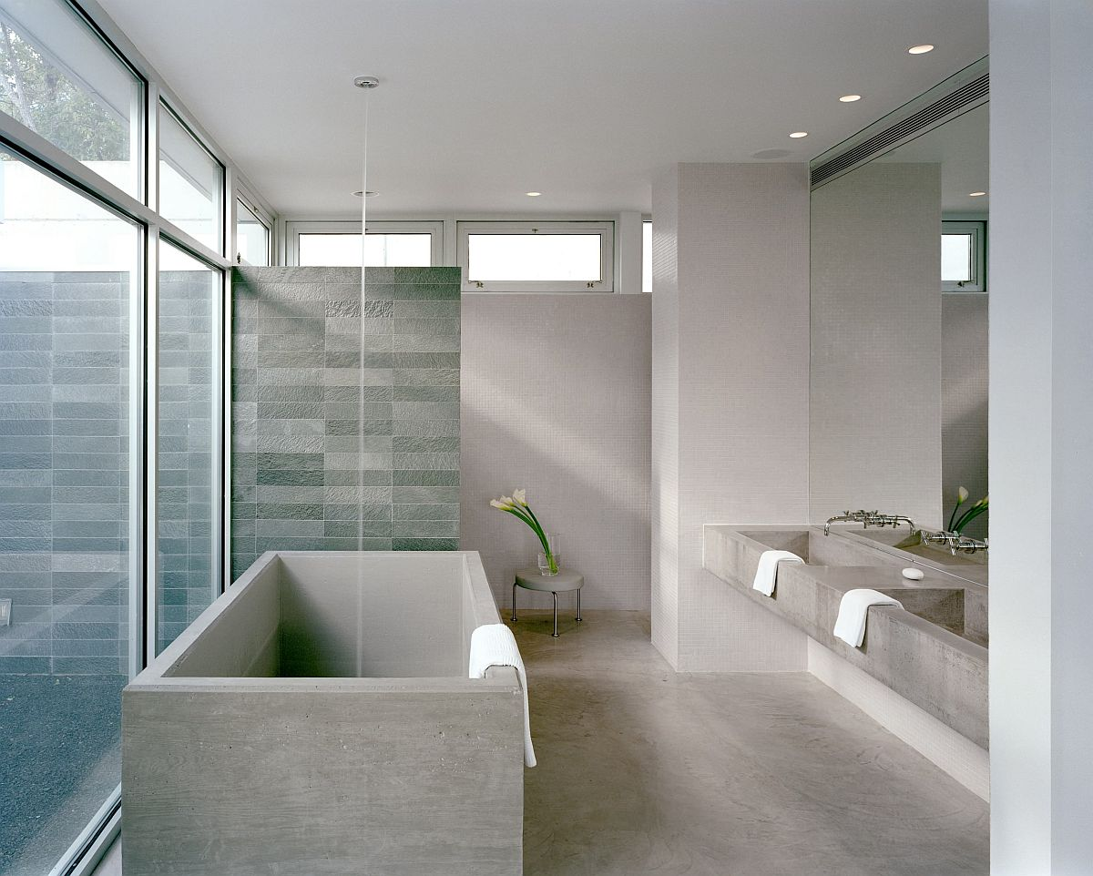 Spacious modern bathrom of New York home in gray with blu tiled shower area