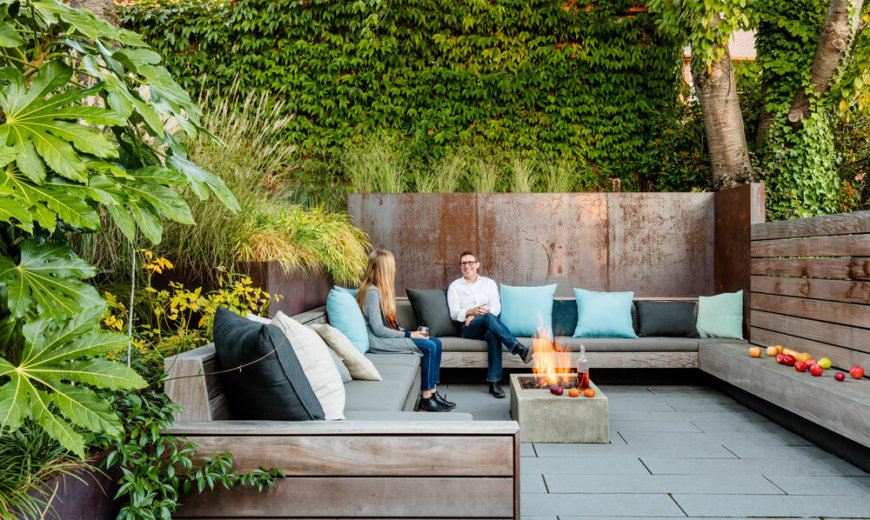 Secluded Outdoor Conversation Pit Surrounded by a Wall of Green