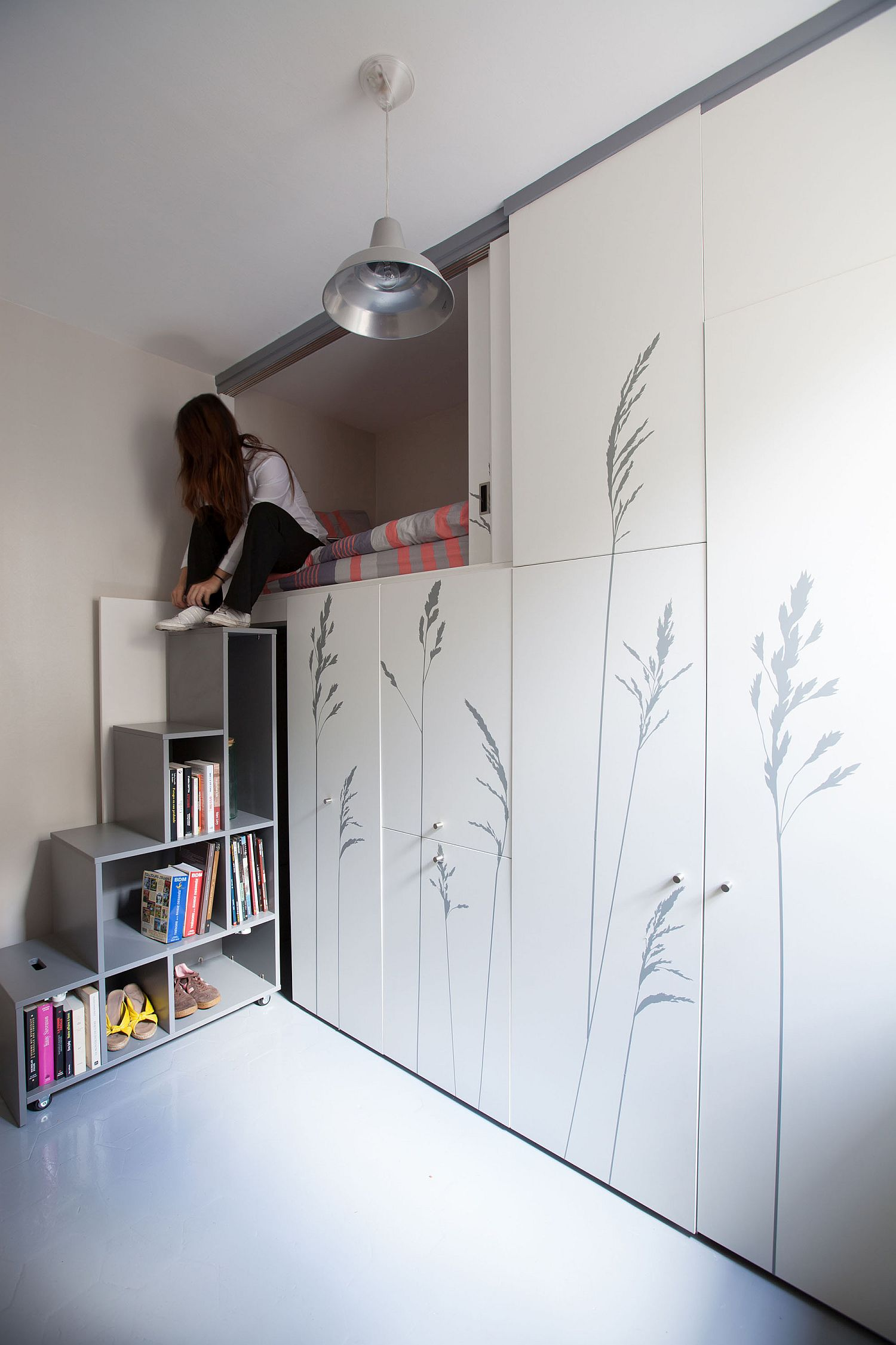 Super-tiny studio apartment with multi-functional wall unit that is just 8 square meters in size
