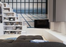 TV-in-the-corner-loft-bed-steps-turned-into-an-open-shelf-and-custom-cabinets-with-ample-storage-in-the-living-area-26058-217x155