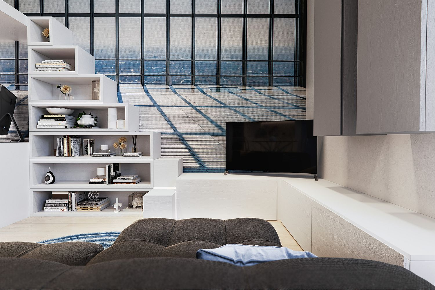 TV in the corner, loft bed steps turned into an open shelf and custom cabinets with ample storage in the living area