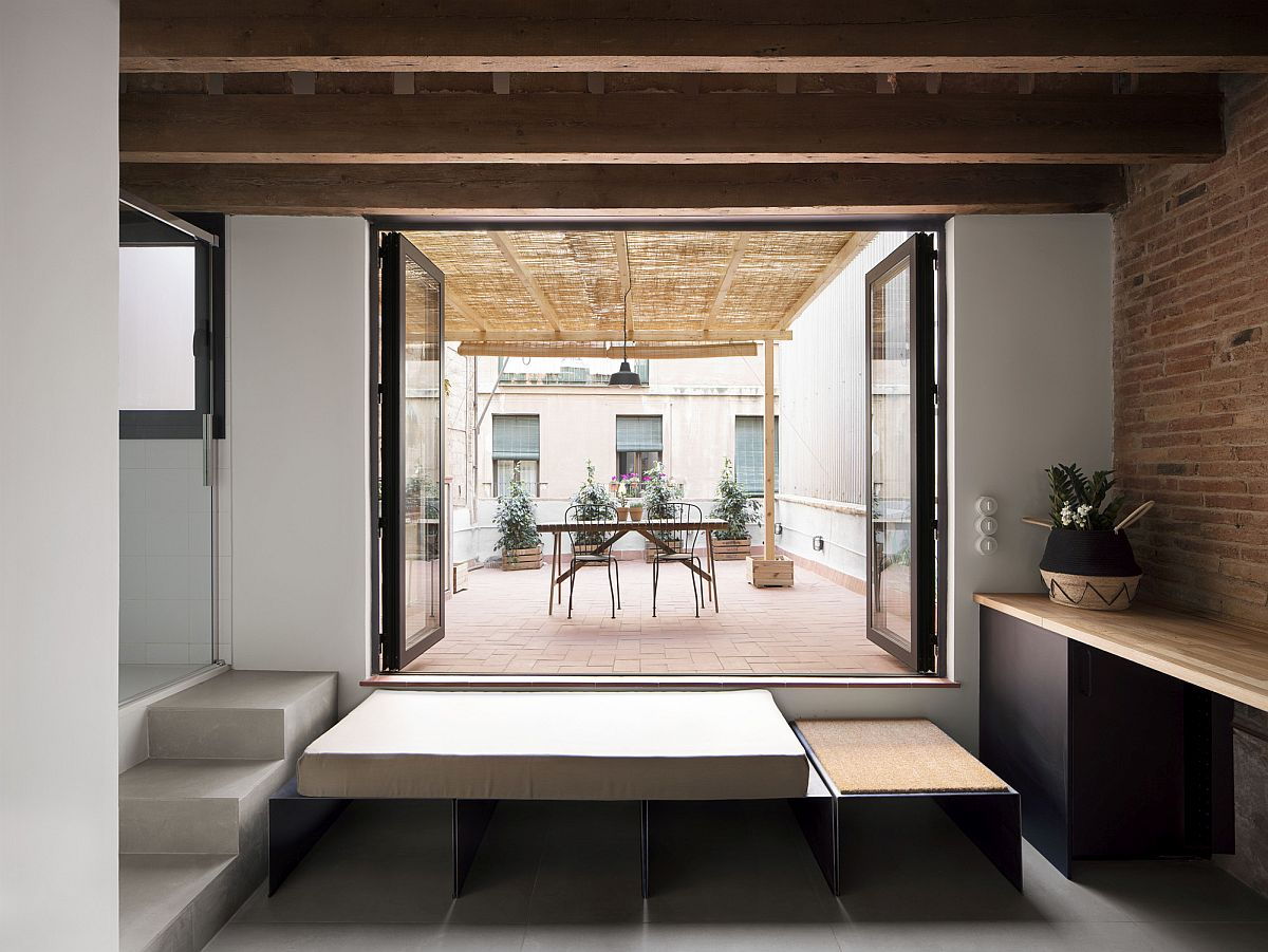 Terrace on a higher level turns the entire small apartment into a sunken lounge of sorts!