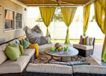 outdoor patio with bright olive green drapery
