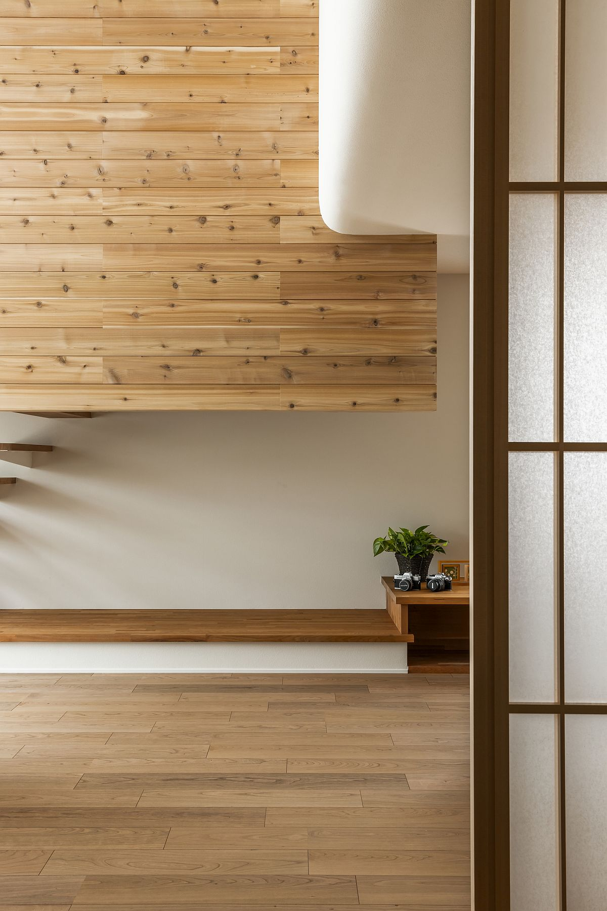 Traditional screens and elements of Japanese design are intertwined with modernity inside this home