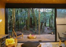 Translucent-sliding-glass-panels-connect-the-interior-with-the-deck-and-view-outside-10430-217x155