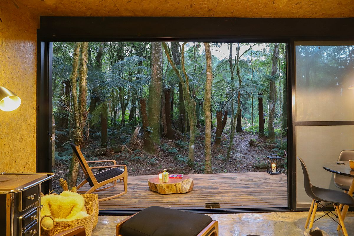 Translucent-sliding-glass-panels-connect-the-interior-with-the-deck-and-view-outside-10430