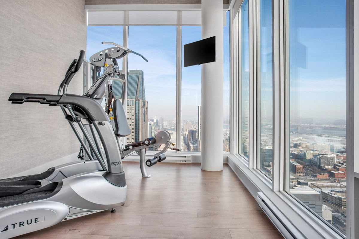 Turn-the-corner-in-the-large-room-with-amazing-views-and-glass-walls-into-a-snazzy-home-gym-60526