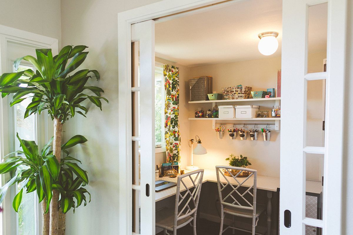 Turn the tiny niche into a small workspace for two with the right desk and decor