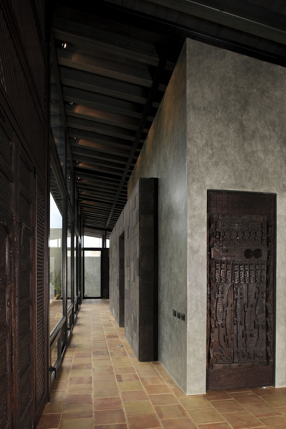 Unique woodwork and doors bring vernacular Mexican charm to the interior