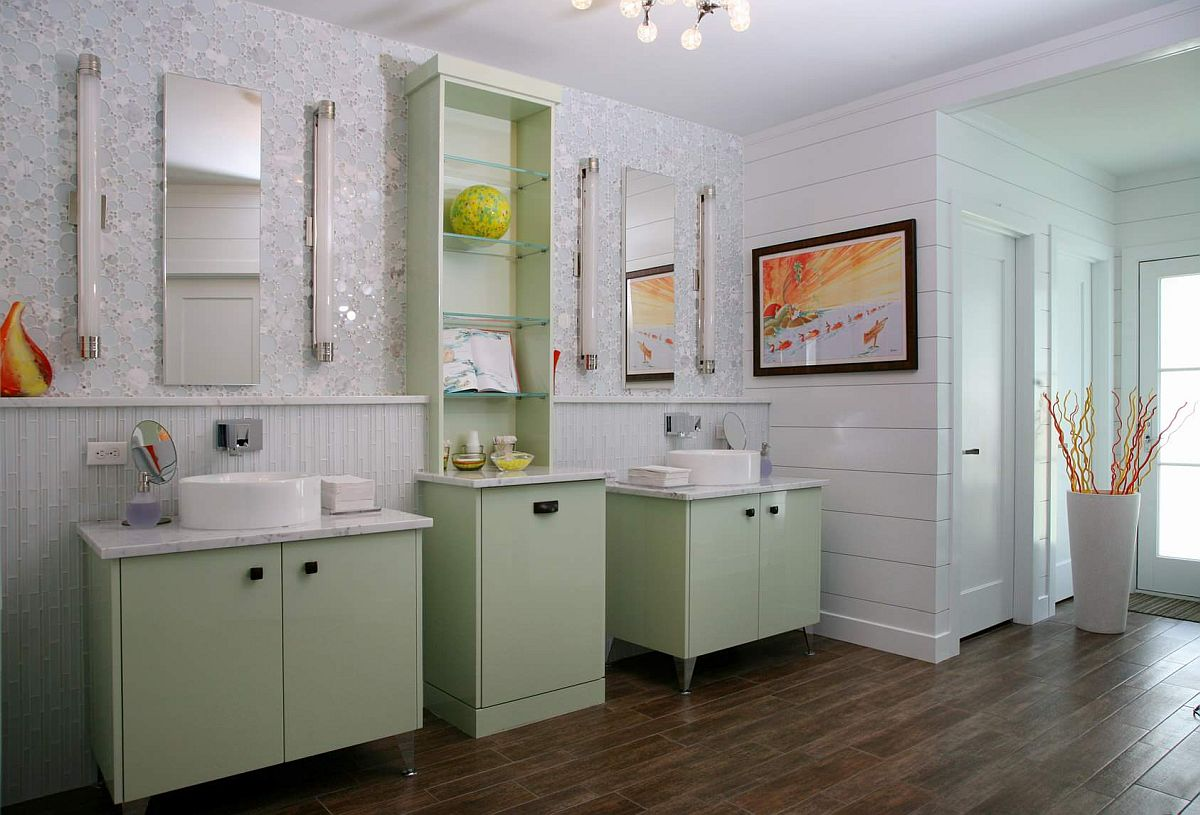 Vanity and open shelves in light pastel green for he white bathroom with wooden floor