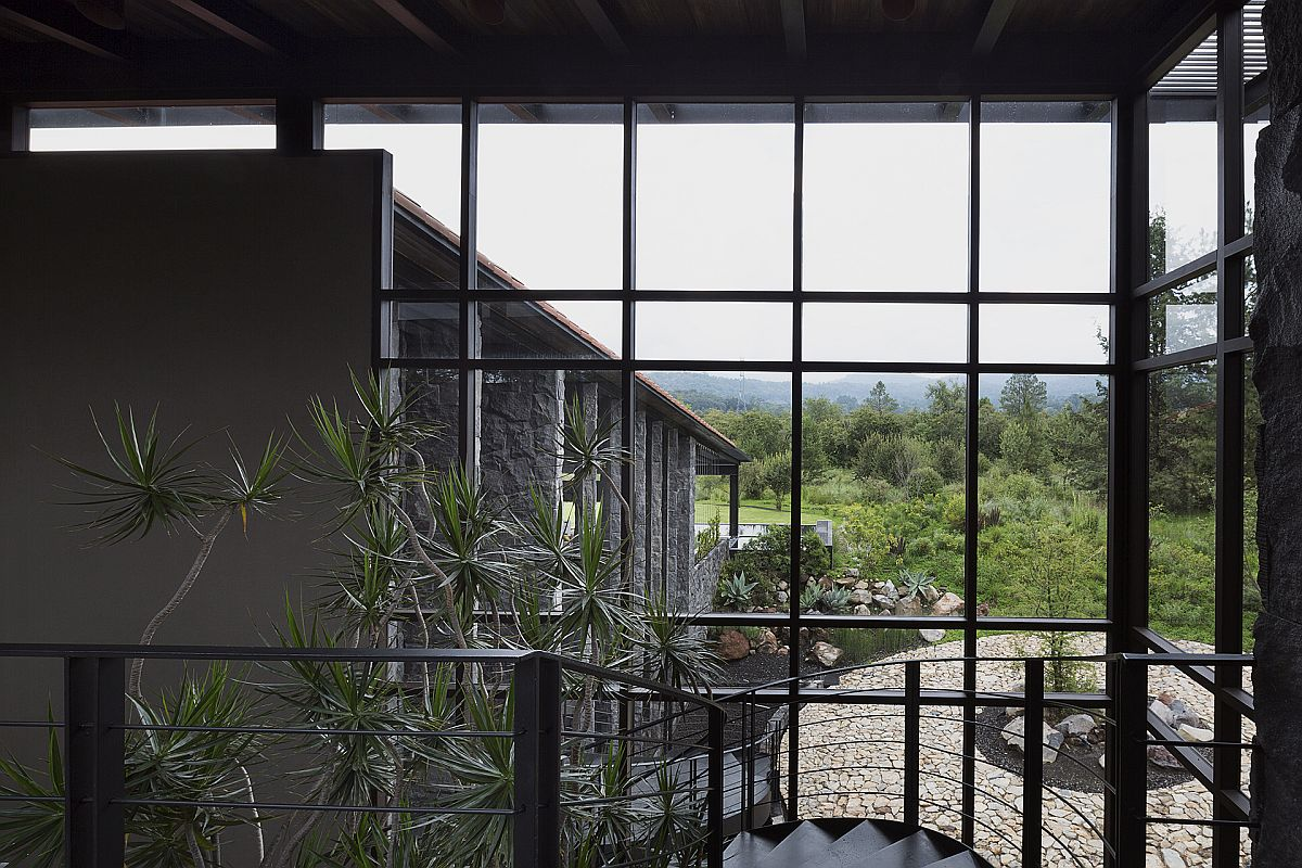 View of the water feature and garden outside the house from top of the stairway