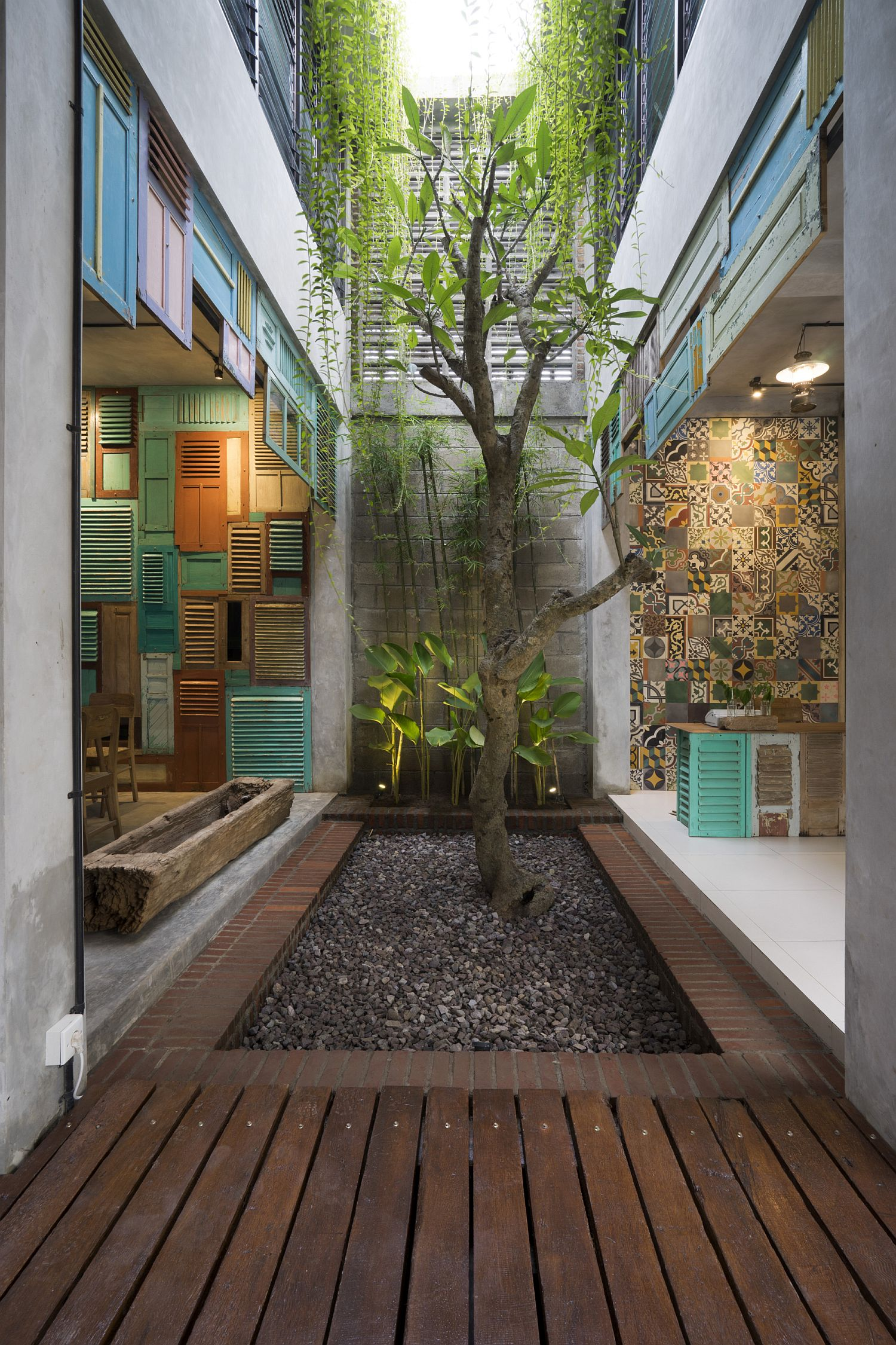 Vintage wooden panels and awesome patterned tiles bring color and uniqueness to this modern atrium