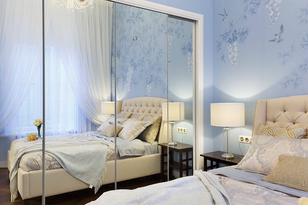 Wallpaper brings both color and pattern to this small bedroom of Saint Petersburg apartment