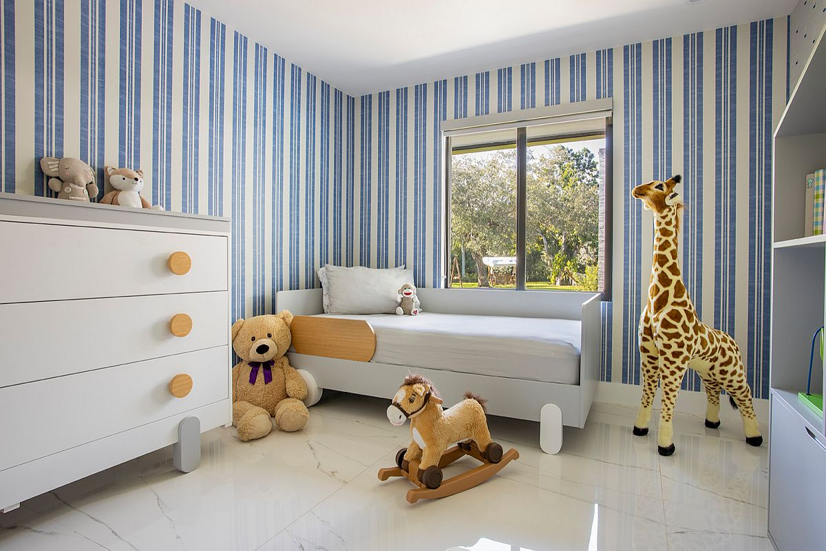 White and blue striped walls enliven contemporary nursery with corner bed
