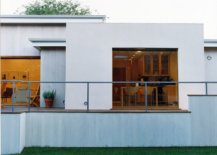 White-extension-of-the-ranch-with-glass-walls-connecting-it-to-the-exterior-16003-217x155