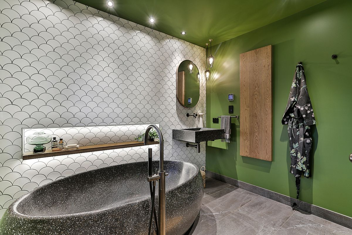 White tiles with fish scale design combined with bright green walls in the innovative bathroom