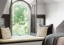 Window-seat-coupled-with-arched-window-gives-the-modern-bedroom-traditional-appeal-91009-217x155