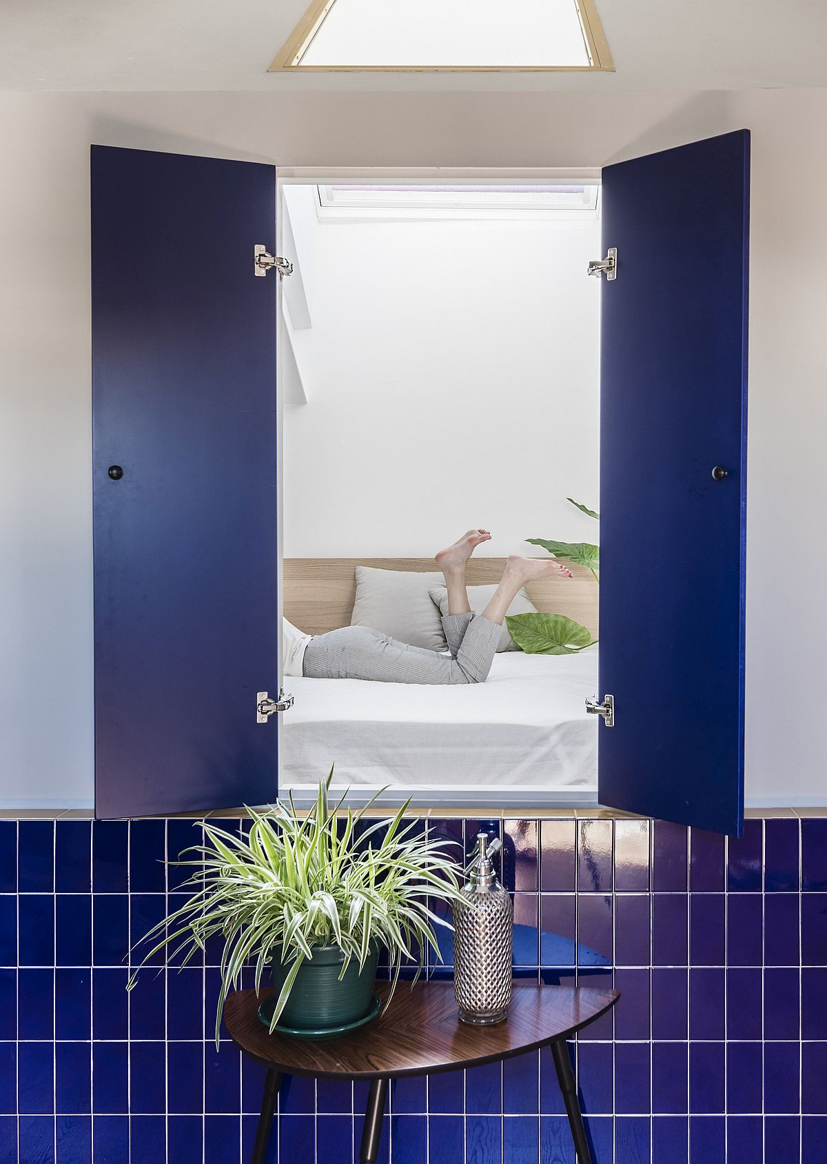 Windows from the bedroom offer a visual connectivity with the living area