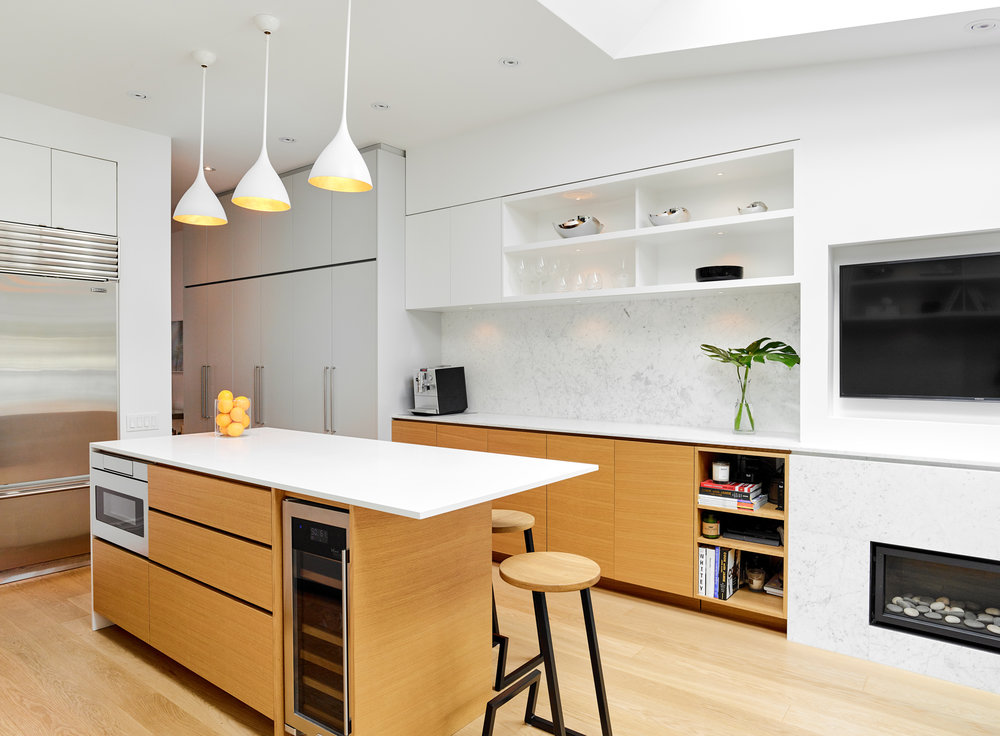 Wood and white kitchens coupled with stainless steel appliances are a hot trend