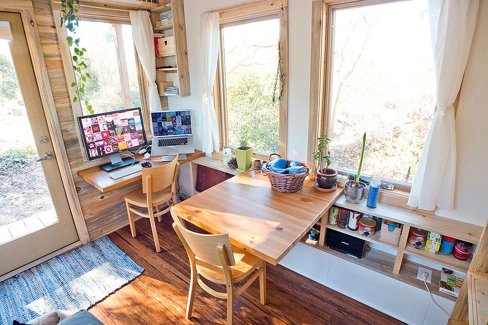 Wooden fold-down desks turn the tiny space into a flexible work area for two