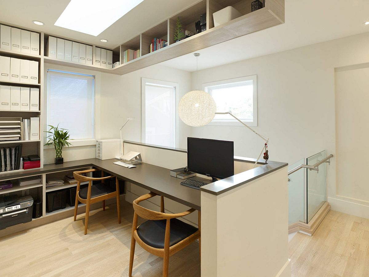 Workspace for two in the staircase landing area ensures you will not have to use another room for hme office