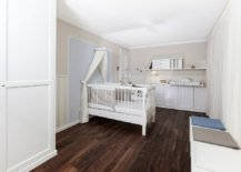 A-bit-of-biege-adds-to-the-elegance-of-this-farmhouse-nursery-in-white-with-wood-floor-and-ample-space-33284-217x155