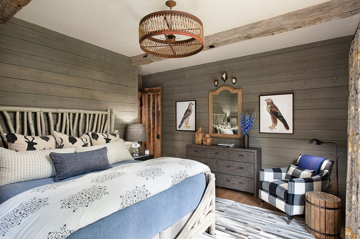 Accent chair and bedding along with framed wall art make the biggest impact in thsi rustic bedroom