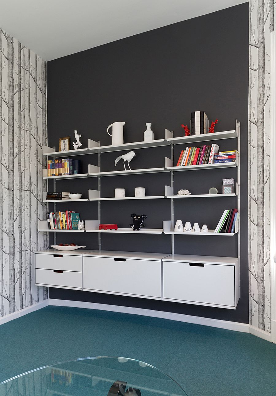 Accent wall in gray along with slim floating shelves for the modern home office