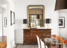 Adding-a-bit-of-opulence-to-the-dining-room-with-gold-mirror-frame-and-dark-table-lamps-23670-217x155