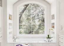 All-white-modern-bathroom-of-the-Texas-home-with-a-view-of-the-leafy-outdoors-79153-217x155