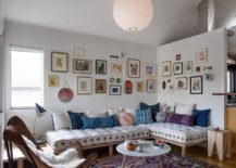 Artwork-collected-from-all-across-the-world-is-used-to-create-a-fabulous-gallery-wall-in-this-living-room-96360-217x155