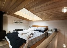 Attic-bedroom-of-the-tiny-cabin-home-with-skylight-above-that-brings-in-ample-natural-light-65142-217x155