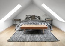 Attic-bedroom-with-ample-natural-light-and-bedding-that-adds-pattern-15532-217x155