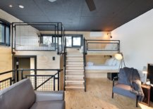 Attic-level-modern-industrial-bedroom-in-wood-and-black-with-smart-decor-34494-217x155