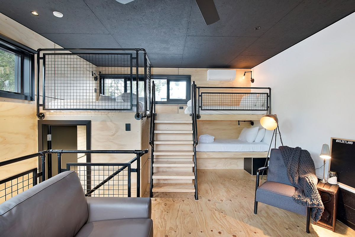 Attic-level-modern-industrial-bedroom-in-wood-and-black-with-smart-decor-34494