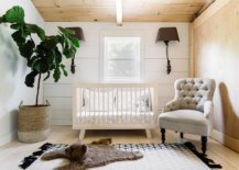 Balanced-gender-neutral-white-and-wood-nursery-of-New-York-home-with-a-dash-of-greenery-to-enliven-it-73399-217x155