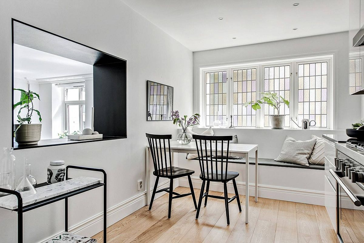 Banquette-style-seating-for-the-small-dining-area-along-with-a-couple-of-black-chairs-does-the-trick-97523