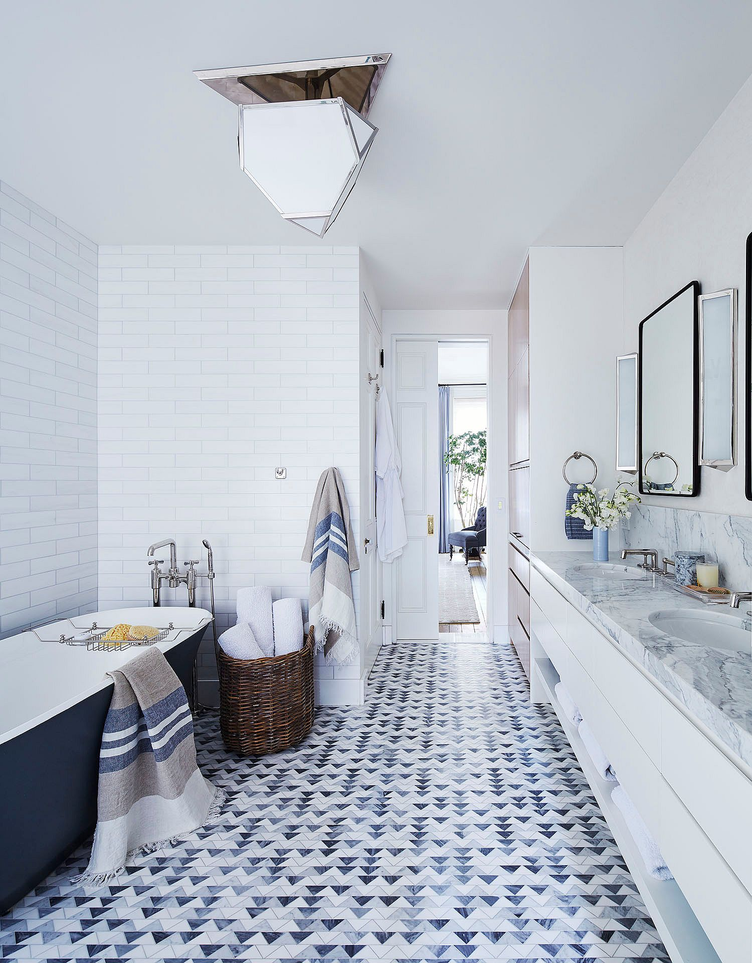 Bathtub adds both color and style to this contemporary bathroom