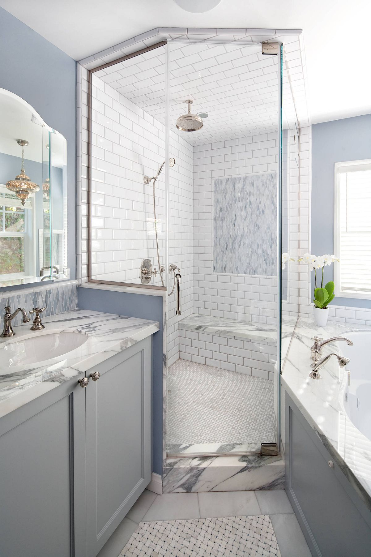 Beautiful beach style bathroom in blue, gray and white with luxurious shower area