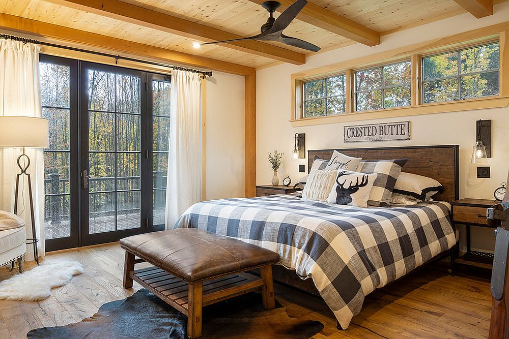 Beautiful modern rustic bedroom in white and wood with bedding that adds checkered pattern