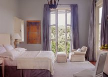 Bedroom-in-white-with-drapes-in-light-blue-and-ample-natural-light-89106-217x155